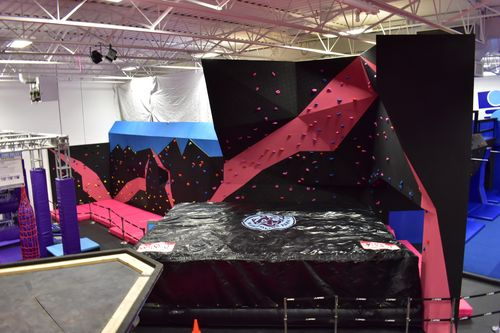 a 21ft. high bouldering/solo climb wall, with custom padding from Canada Crash Pads and giant air bag, just for kicks.